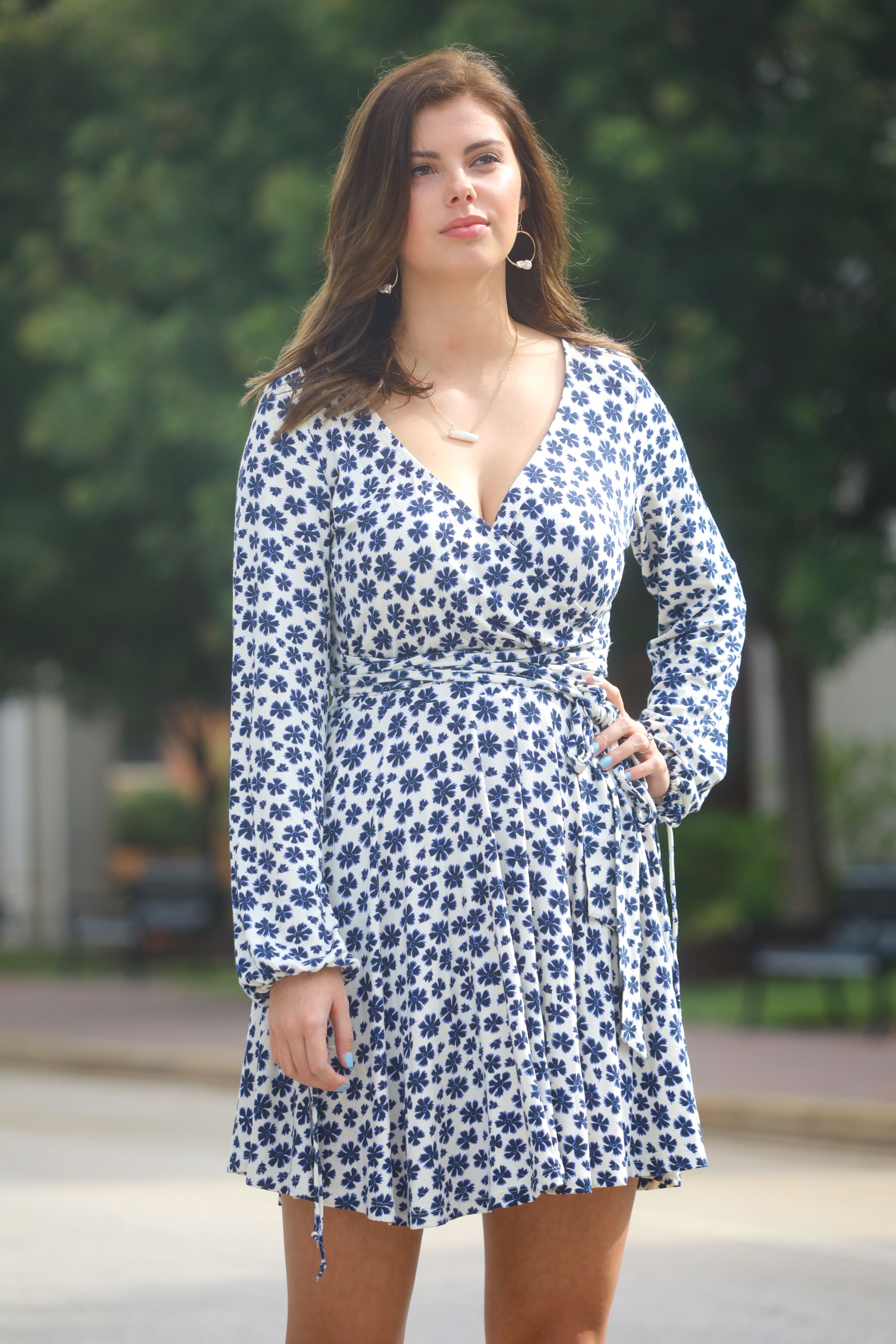 49ad75cc0dae Free People- Pradera Wrap Mini Dress Item #: 74457 Color: Blue Combo  Description: Printed tunic top featured in a shapeless silhouette. V-Neck.