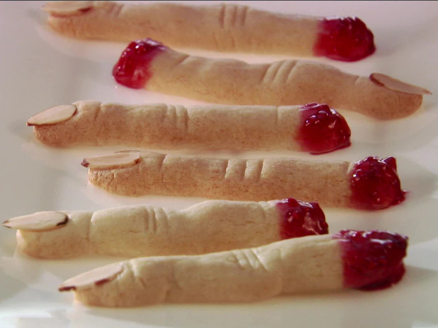 Food network and hgtvs ultimate halloween party witch finger witch finger cookies giada de laurentiis transforms classic ladyfinger cookies into spooky witch fingers by foodnetwork forumfinder Gallery