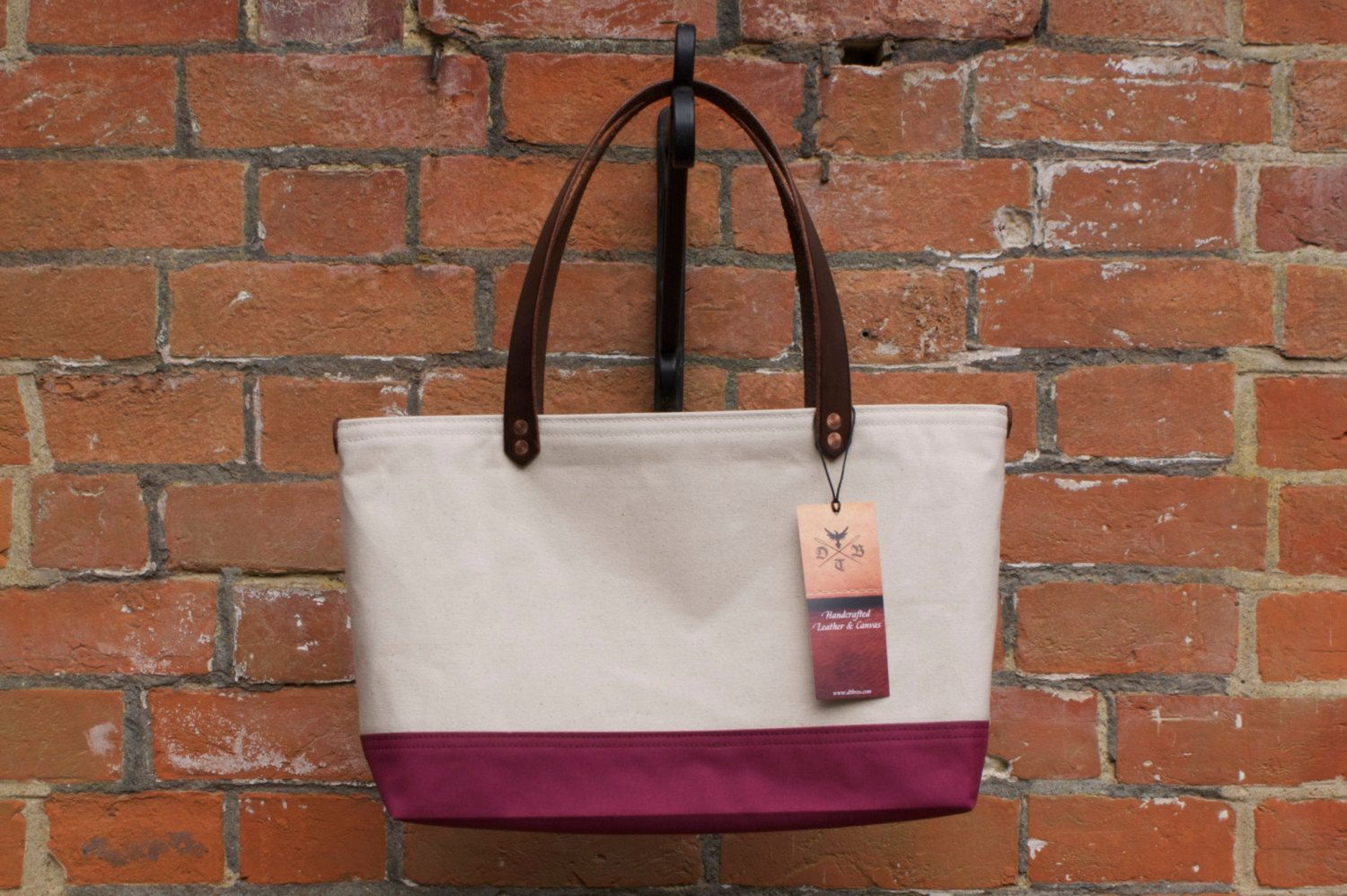 DTB Porta: Large beige & burgundy canvas tote with full grain black English leather handles and solid copper rivets. Available on Etsy and Folksy under DTBros shop.