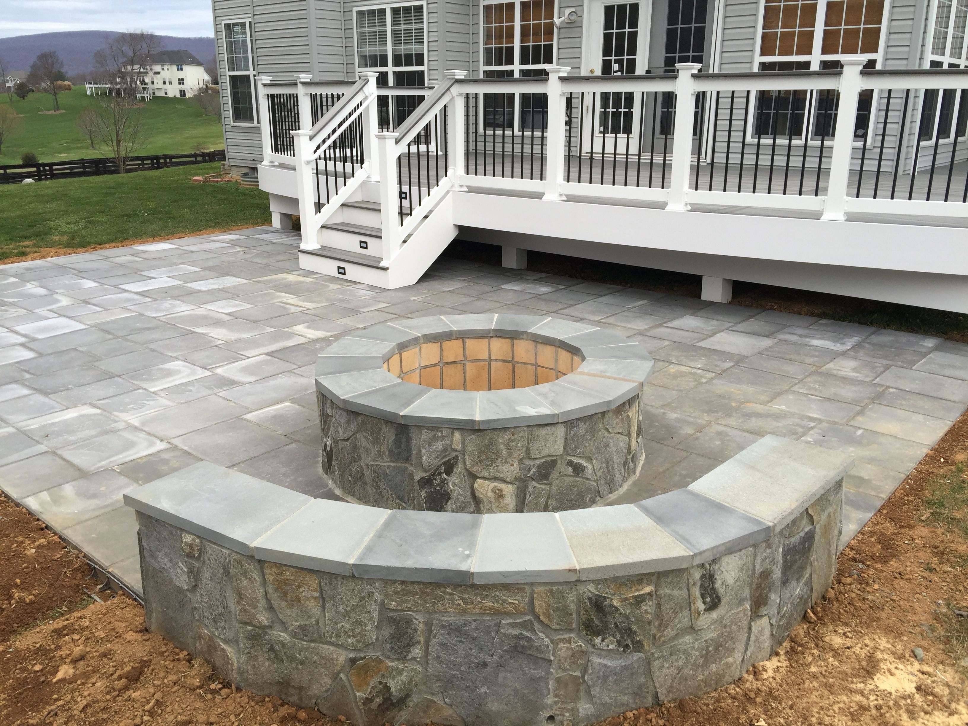 Paver Patio Installers Near Me Elegant A Beautiful Paver Patio With Stone Seating Walls And A Fire Pit Patio Deck Designs Patio Stones Backyard Patio Designs