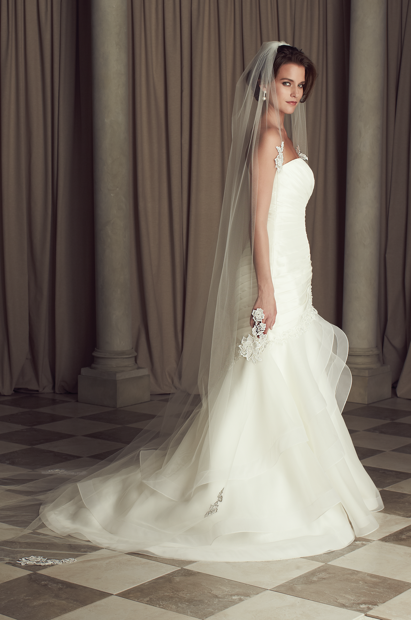 One tier fingertip or chapel length veil with scattered guipure