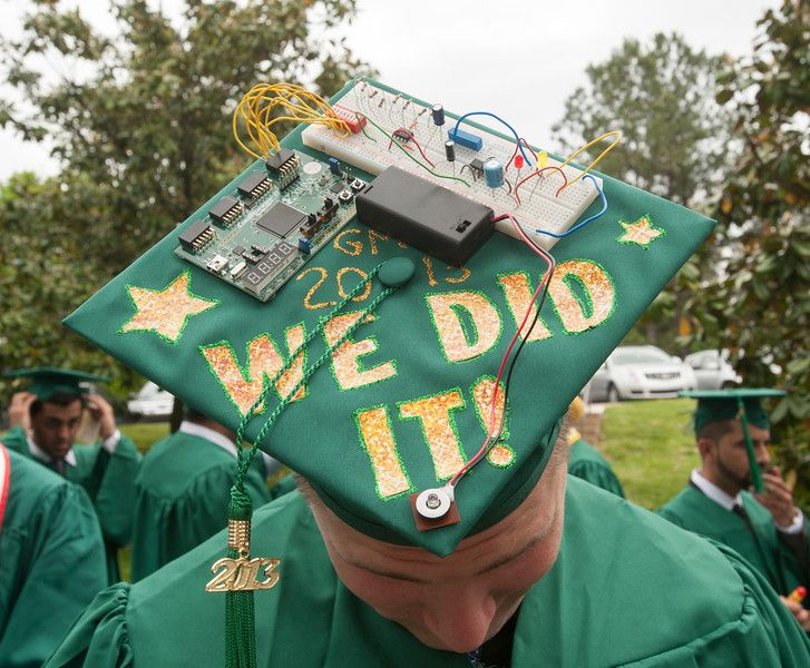 A student wears a decorated graduation cap at the Volgenau School of ...