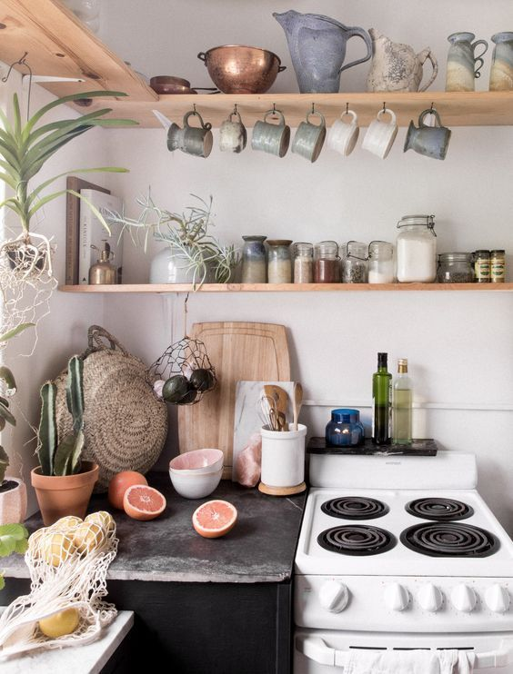 Photo of Domestic kitchen with rustic DIY flair. Open shelves, glasses, plants, small …