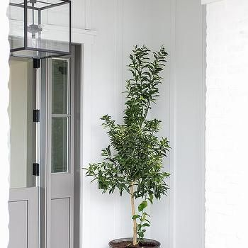 Gray Dutch Front Door with Galvanized Metal Planter