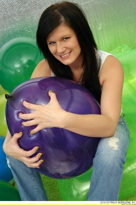 Squeezing big balloons to pop wwwballoonmoviescom  www