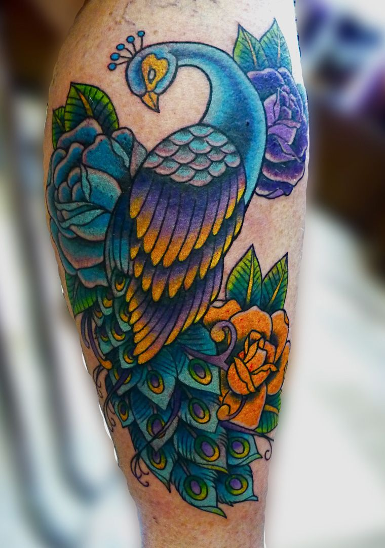 Peacock flower tattoo designs - Beautiful Cool Peacock Feather Tattoo Pictures Designs And Meanings For Females And Males Colorful Images Of Peacock Tattoos On Arm Shoulder And Back