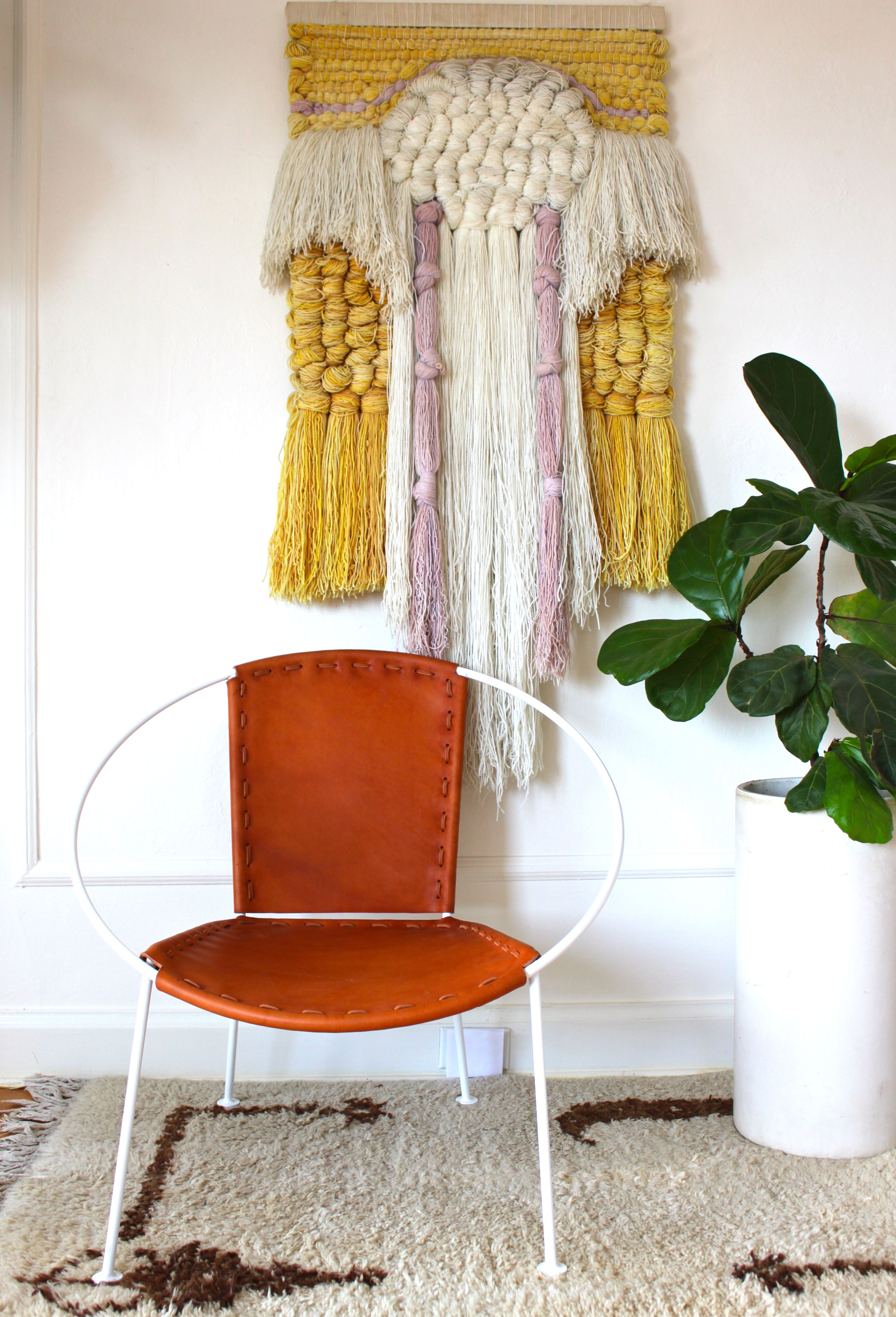 Memory of a Circle chair from MODERNHAUS @modernhaus paired with vintage fiber art / weaving from @morgansatterfield