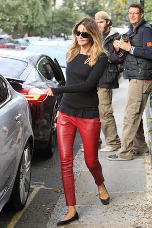 Elle McPherson in red leather pants