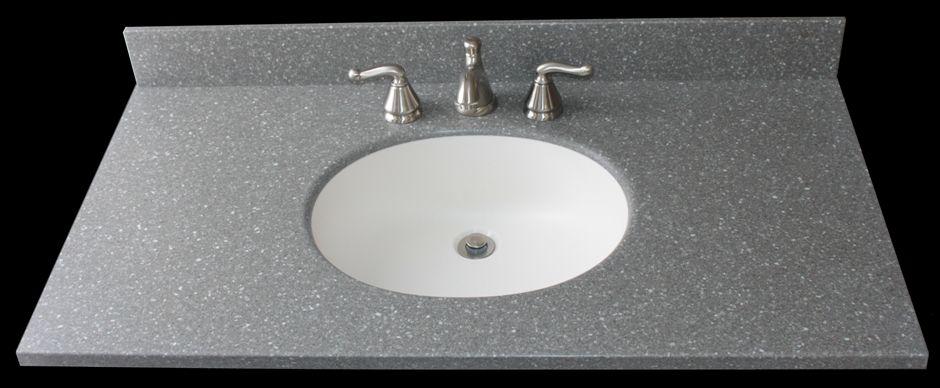bathroom sink with corian countertops