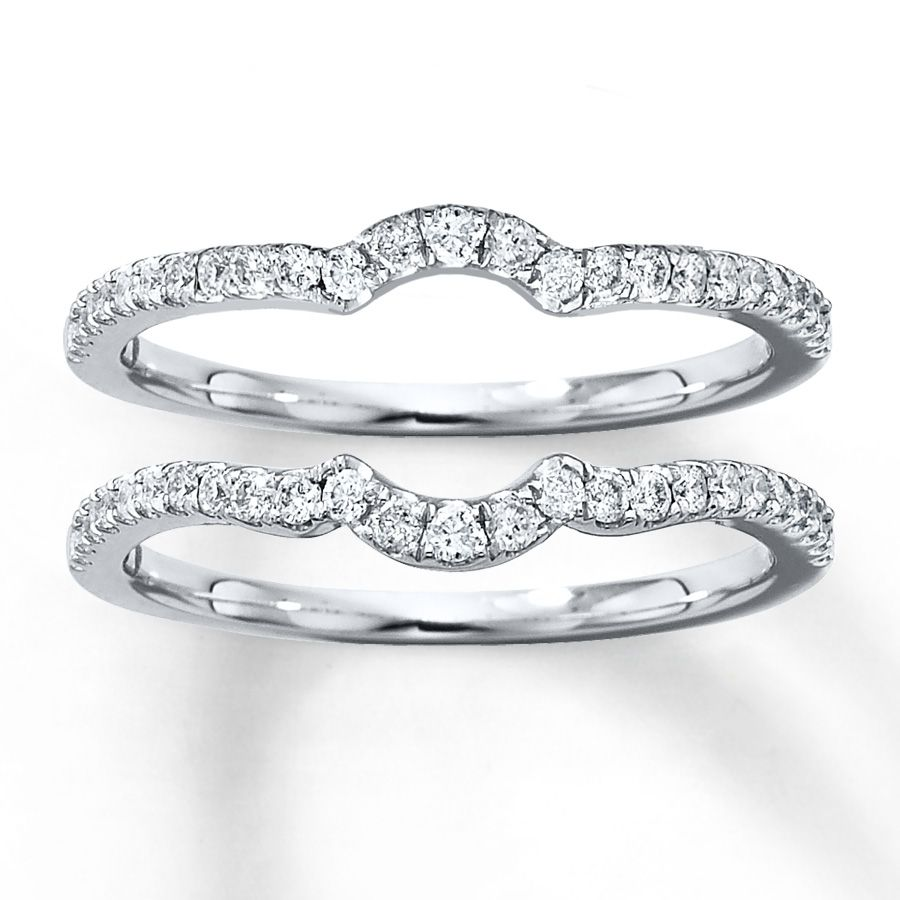 a single row of diamonds curves along each of these matching double wedding bands for her crafted in white gold these rings have a total diamond weight of - Double Band Wedding Ring