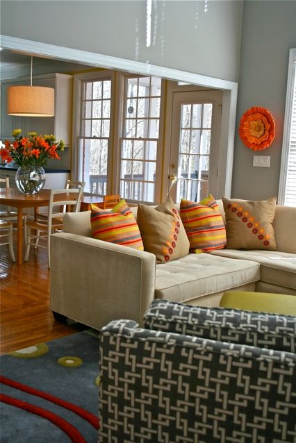 Living Room Gray Walls Beige Sofa Bright Accents Orange Blue Red