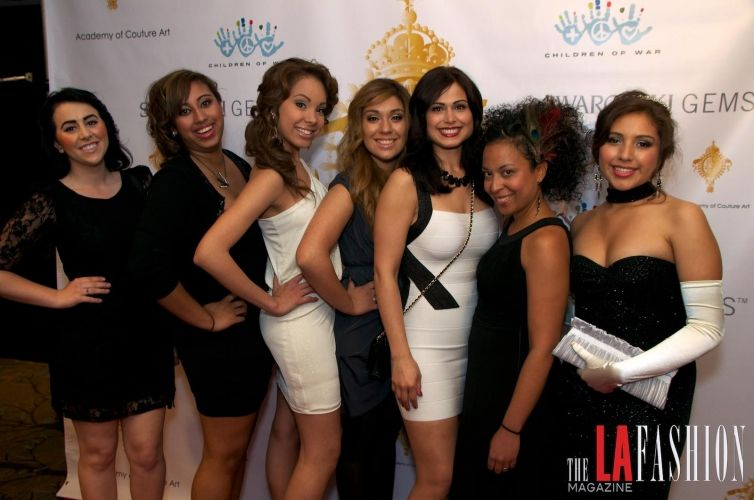 The girls of Paul Mitchell The School Portland at the Le Reve Fashion Show in Los Angeles, California after doing the models' hair and makeup.