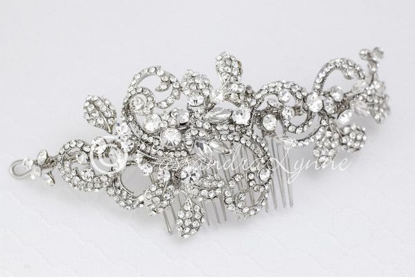 Add this bridal headpiece to your wedding day look and you will receive many compliments! It is a wonderful design of rhinestone covered swirls, marquise jewels #bridalheadpieces