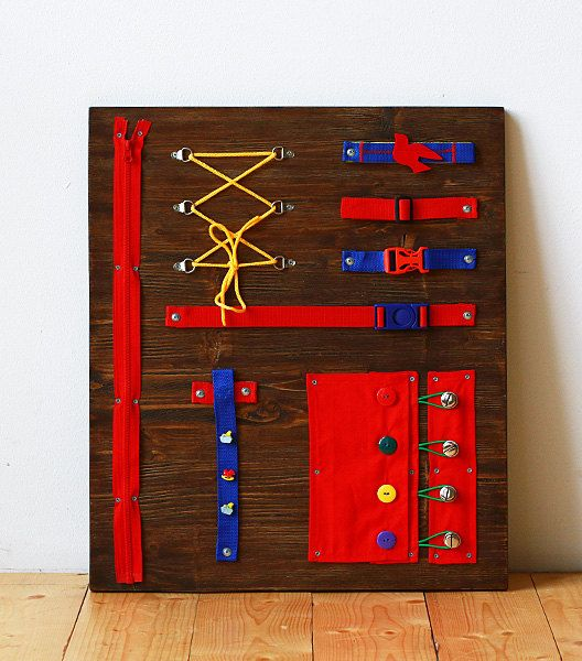 Educational board with cloth items. Develops self-care skills. Adaptation to household arrangements. The busy board is of high quality, durable product, that can be enjoyed for years. Made of solid wood with wavy surface and aqueous coating. Adult supervision is necessary when child is playing with the toy. Age: 1,5 to 4 years. Size 50 x 60 sm. Touching board is a benefit for everyone! For you: Leisure time, Your kid develops his skills while playing, Personal design. For your kid: Has hi...