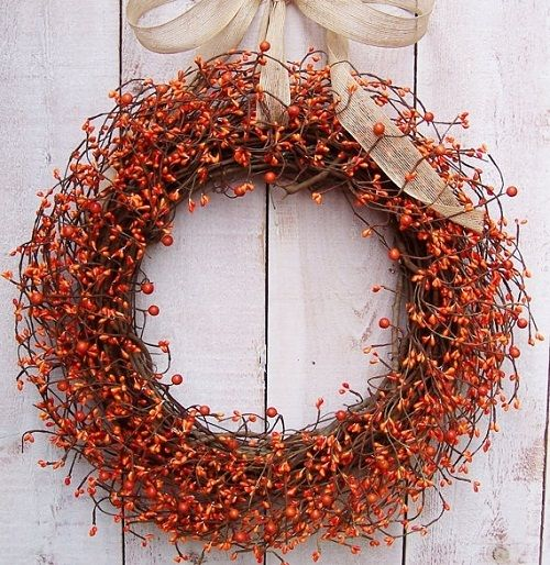Creative Fall Decorating Ideas for a Grapevine Wreath. Learn how to gather seasonal colors and foliage to craft beautiful and inviting fall wreaths. Thanks to Etsy Shop 'An Extraordinary Gift' for letting us feature. #fall #wreaths #tutorial