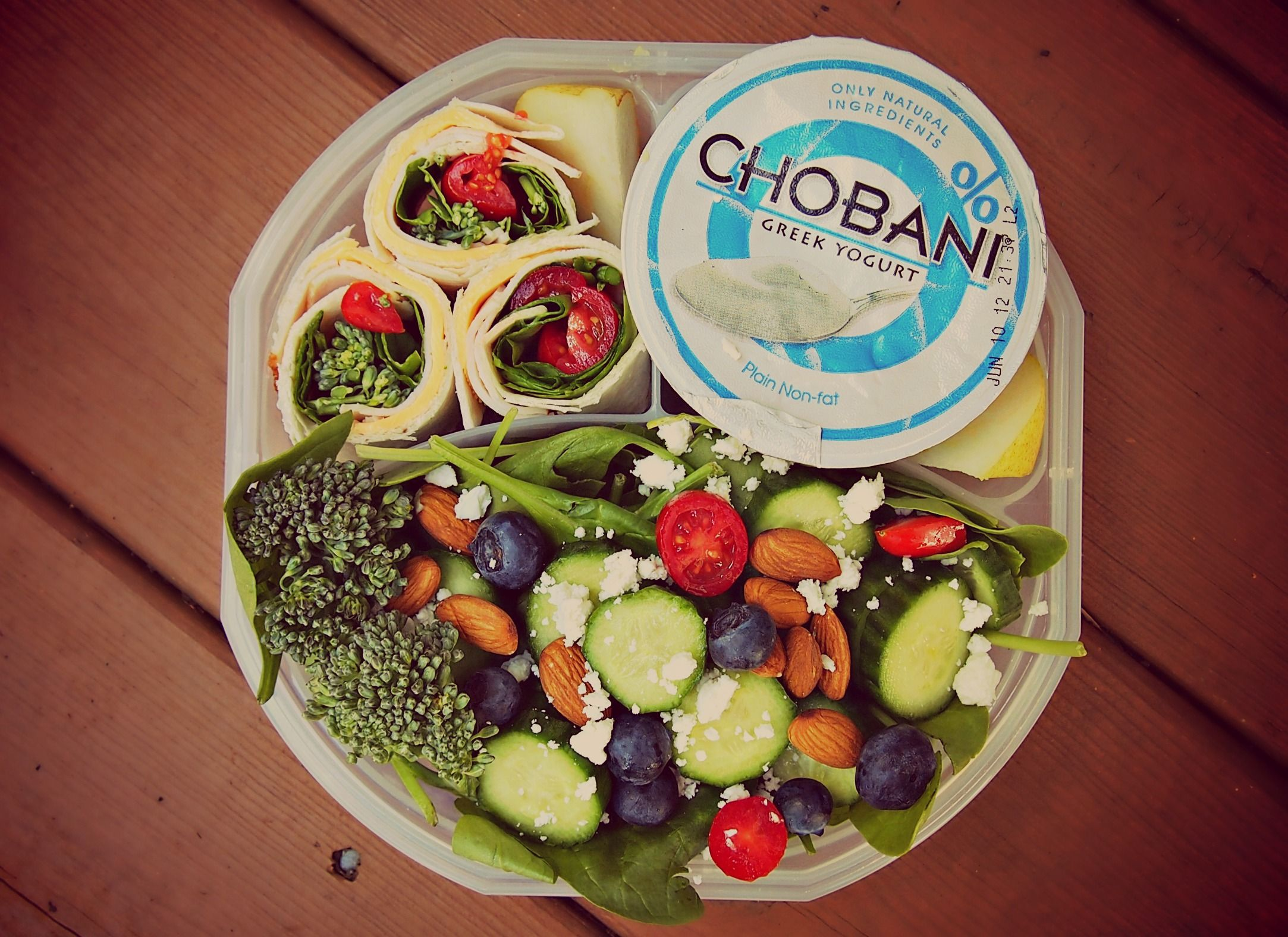 On the bottom, a little salad with spinach, cucumber, blueberries, cherry tomatoes, feta, broccoli and almonds. Top right is plain Chobani (can add Mio). Tiny pear slice next to the yogurt, had to fit it in there somewhere. Top left is a little wrap with tofurky (vegetarian turkey), American slice cheese, spinach, 50 calorie whole grain tortilla, and cherry tomatoes rolled up and sliced.