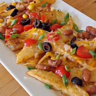 """Quick Potato Nachos I """"The family loved these! The more toppings the better."""" (Nacho Cheese Fondue)"""