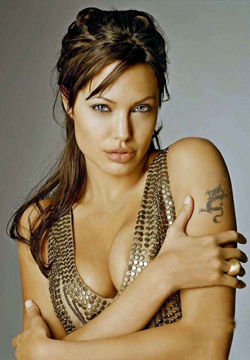 Hollywood Actress Angelina Jolie Hot and Spicy Cleavage Photos