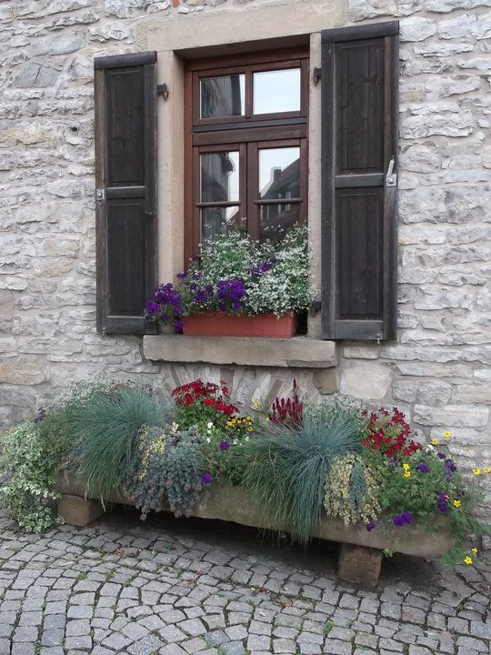 A flower box on legs to set on the ground under the window