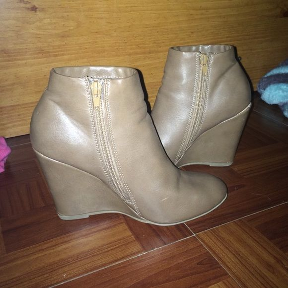 Tan Wedged Booties There is a small scratch but isn't noticeable. These are super comfy and look so cute. Shoes Ankle Boots & Booties