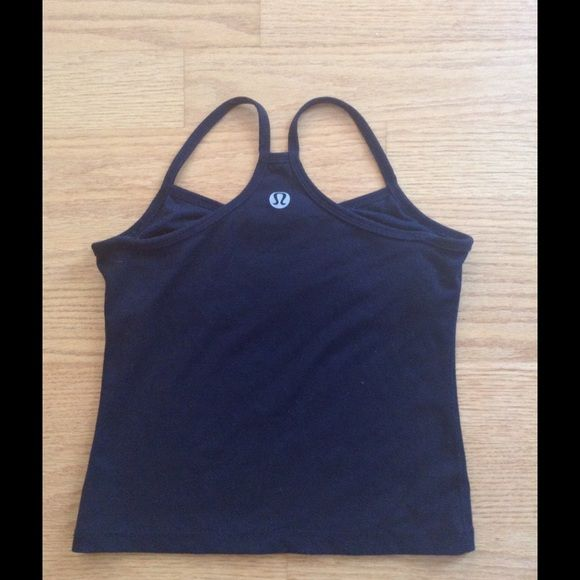 """SOLD-Lululemon black, power Y tank top Original style luon fabric black power y tank top.  Shelf bra (no cups or slits for cuts).  Light pilling on outside, most pilling on inner bra (is a more cotton like material).  Large logo on back. Unstretched 17"""" from top of strap to hem, 11"""" armpit to hem, 14"""" chest, 14"""" hem. lululemon athletica Tops Tank Tops"""