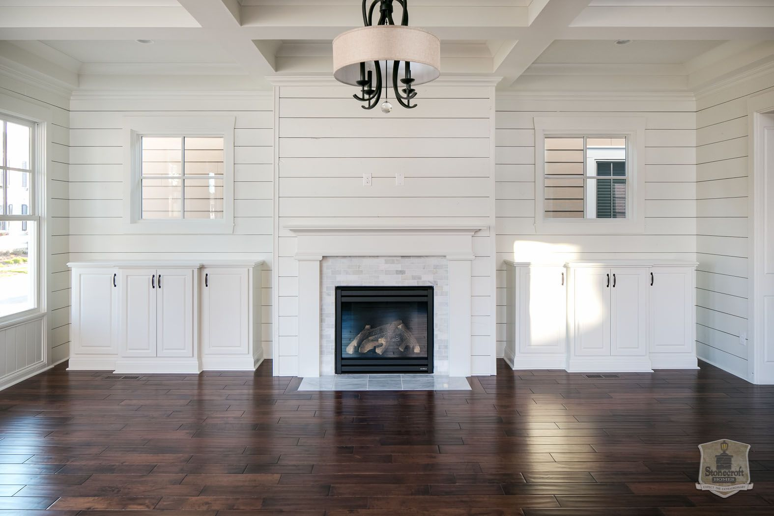 Love this marble and shiplap fireplace design finishes