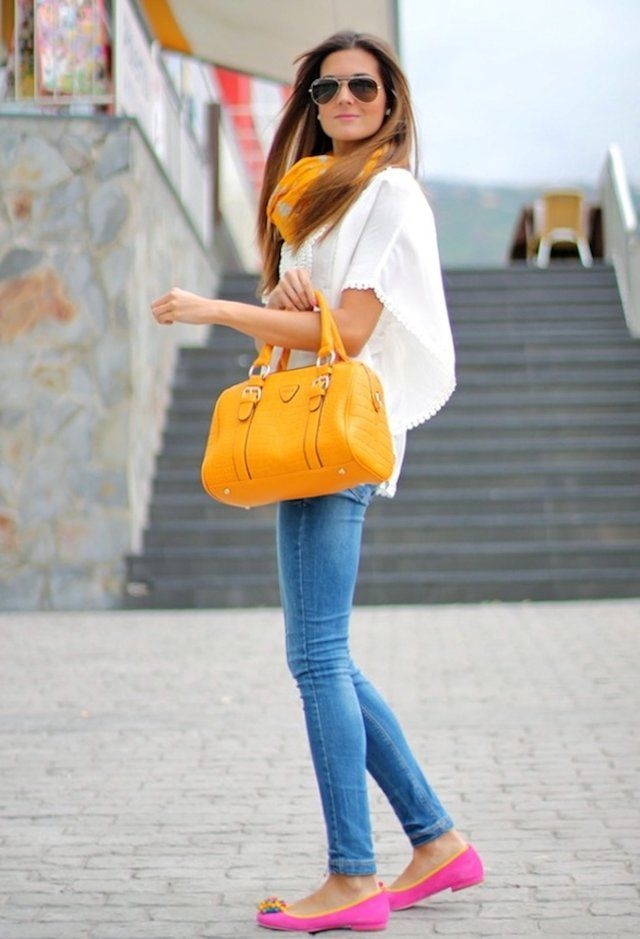 Basic blue jeans and white tee with bright pops of color. I might add pink lips as well.