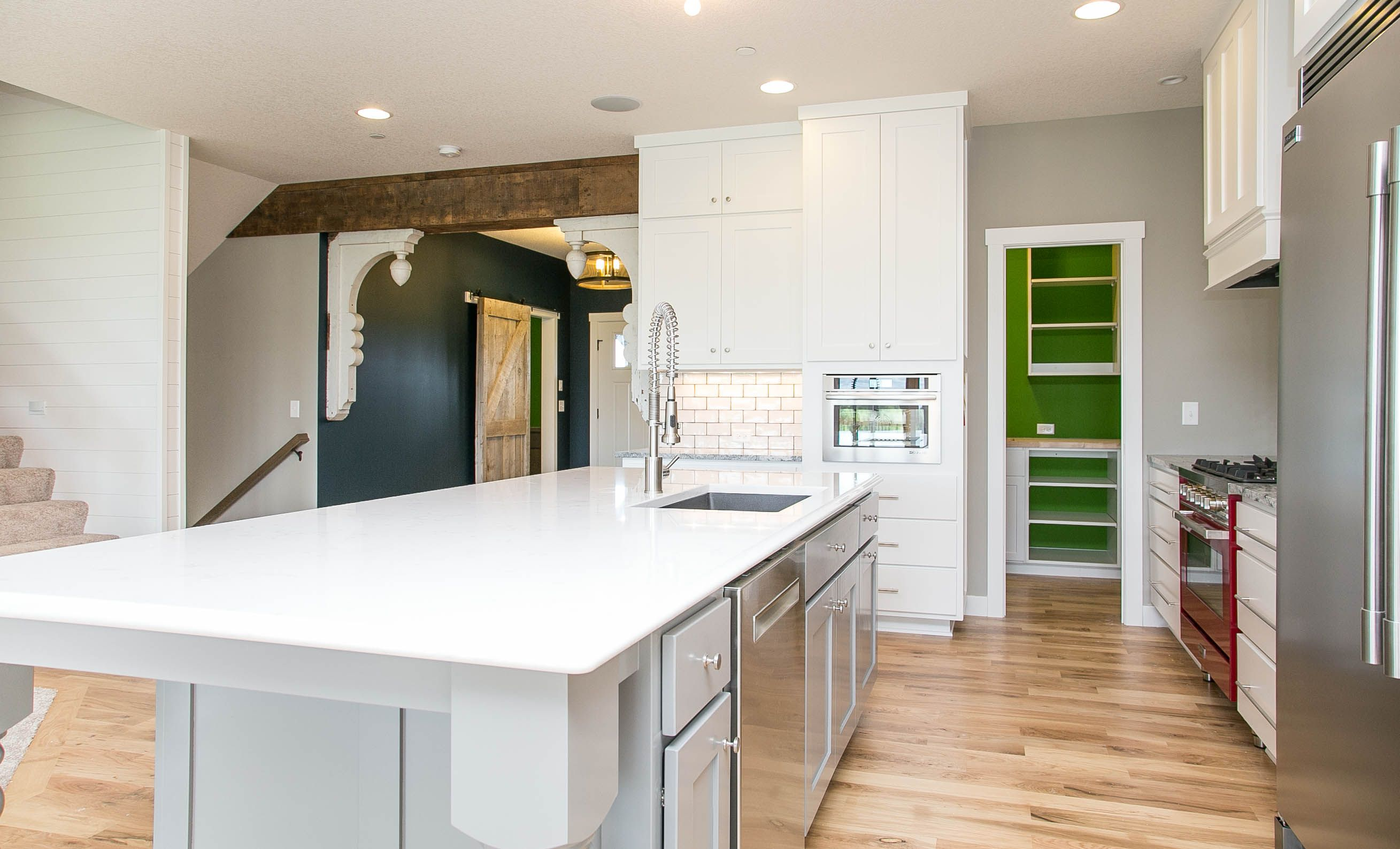 Custom kitchens are our specialty! This LDK kitchen is like no other! The enameled cabinetry and white ceramic backsplash create a clean, elegant look that is absolutely stunning!