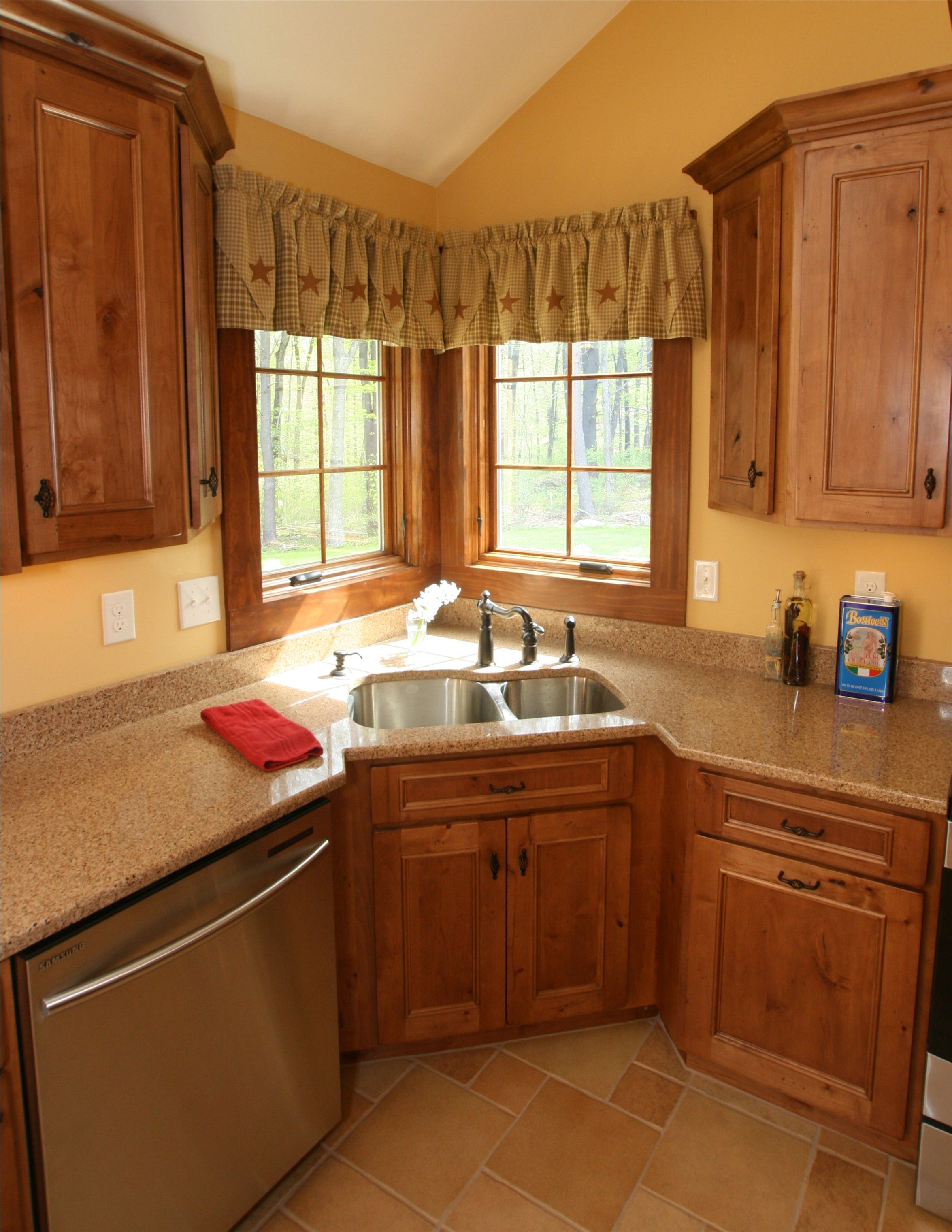 this is a beautiful showplace kitchen featuring our rustic alder
