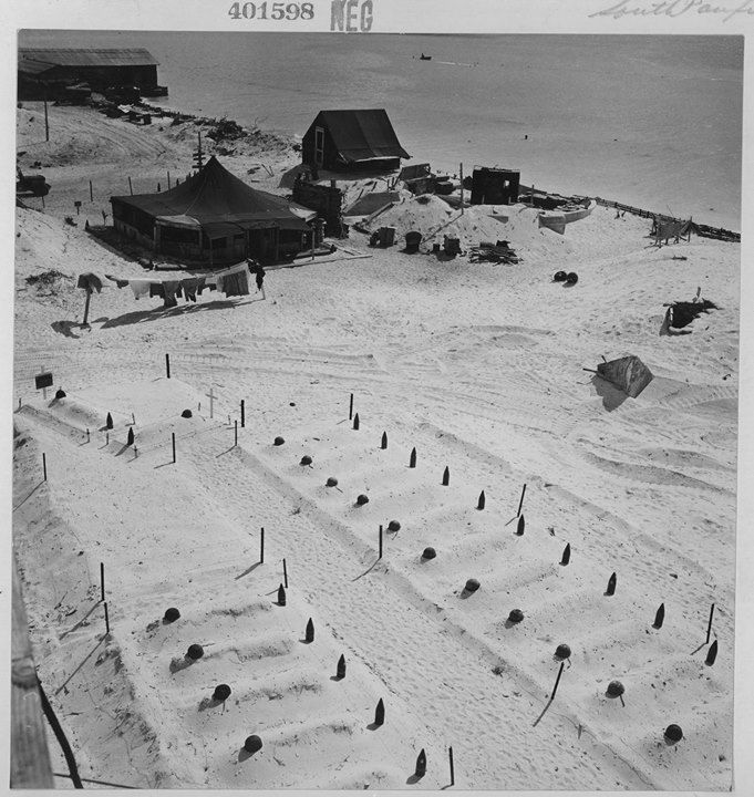 Empty helmets and spent artillery shells mark the graves of Marines who fell at Tarawa March 1944.