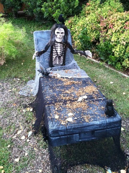 A coffin made from an old plastic tool box for a truck bed