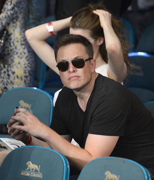 Description of  Elon Musk is seen during a 152-pound title fight - ceo description