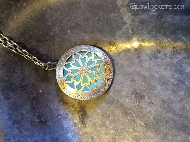 This is a Glowlocket; handmade in New Orleans. The insert actually absorbs light and glows brightly! Unique; isn't it?