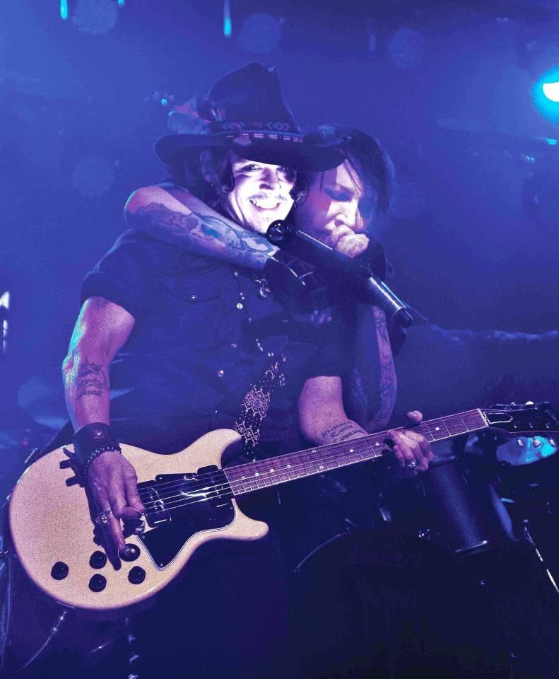 Johnny Depp plays lead guitar on stage with Marilyn Manson