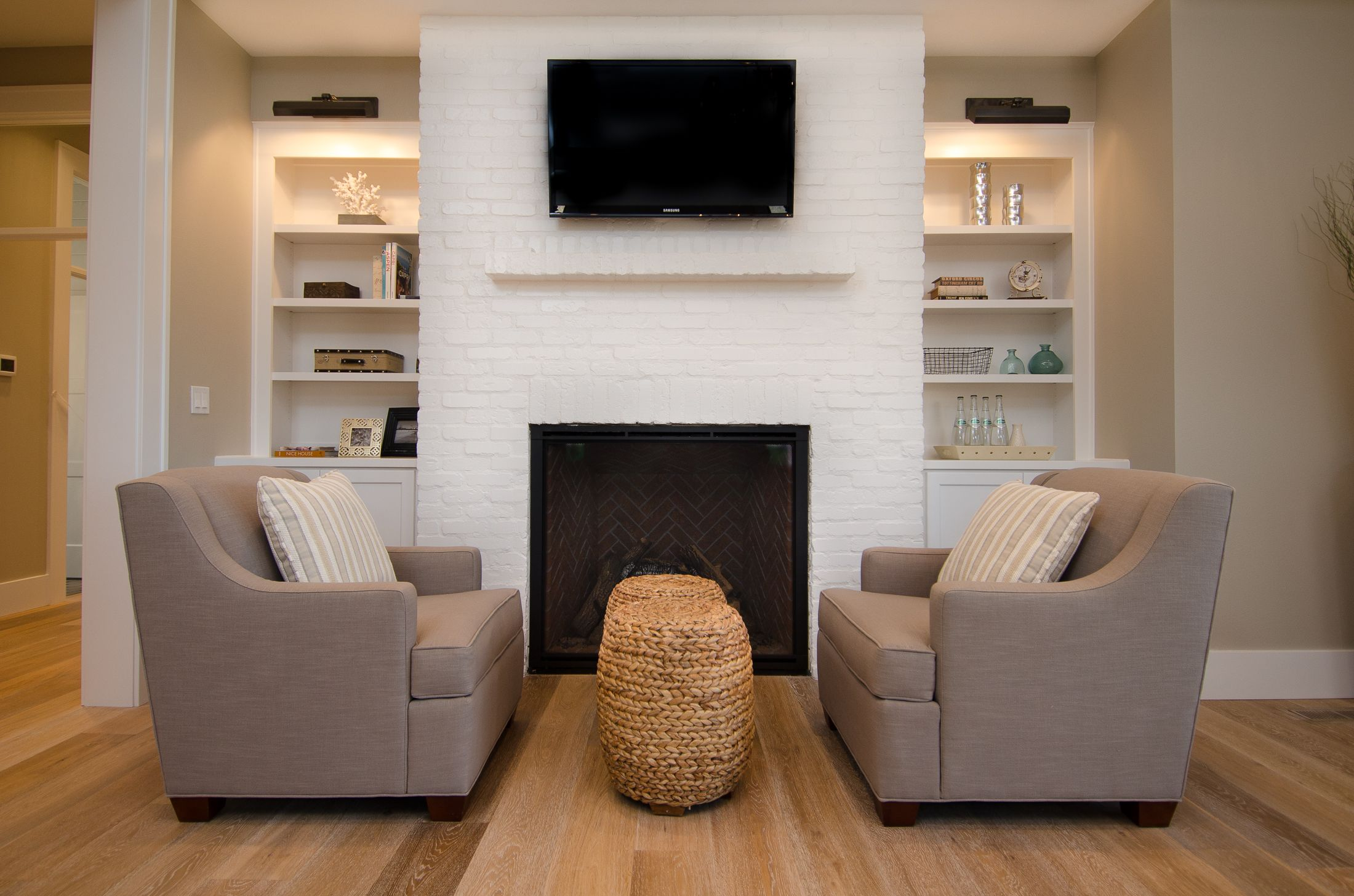 Painted Brick Fireplace With Built Ins