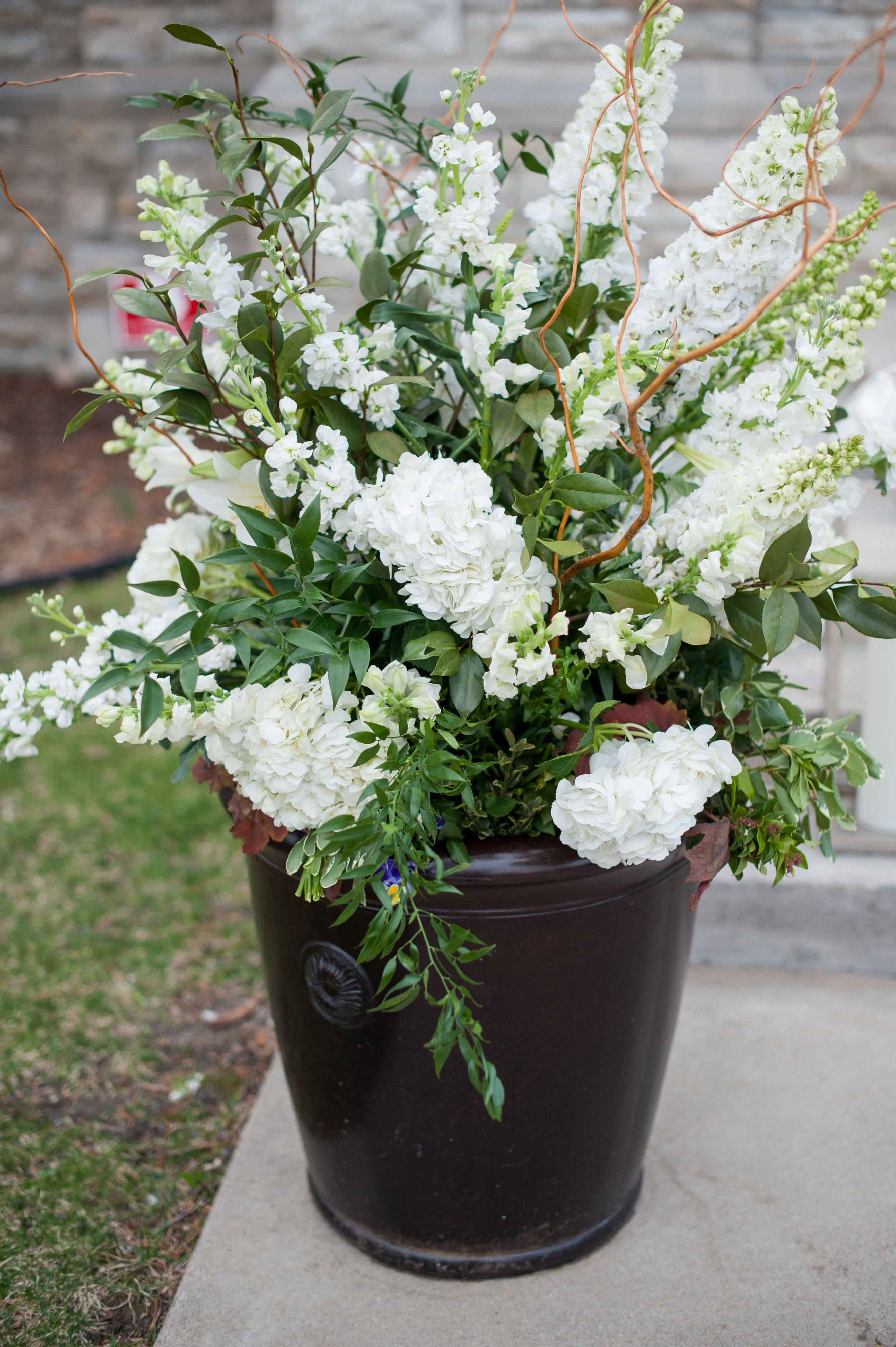 Various White Floral With Green Filler In Large Urn Church Entrance