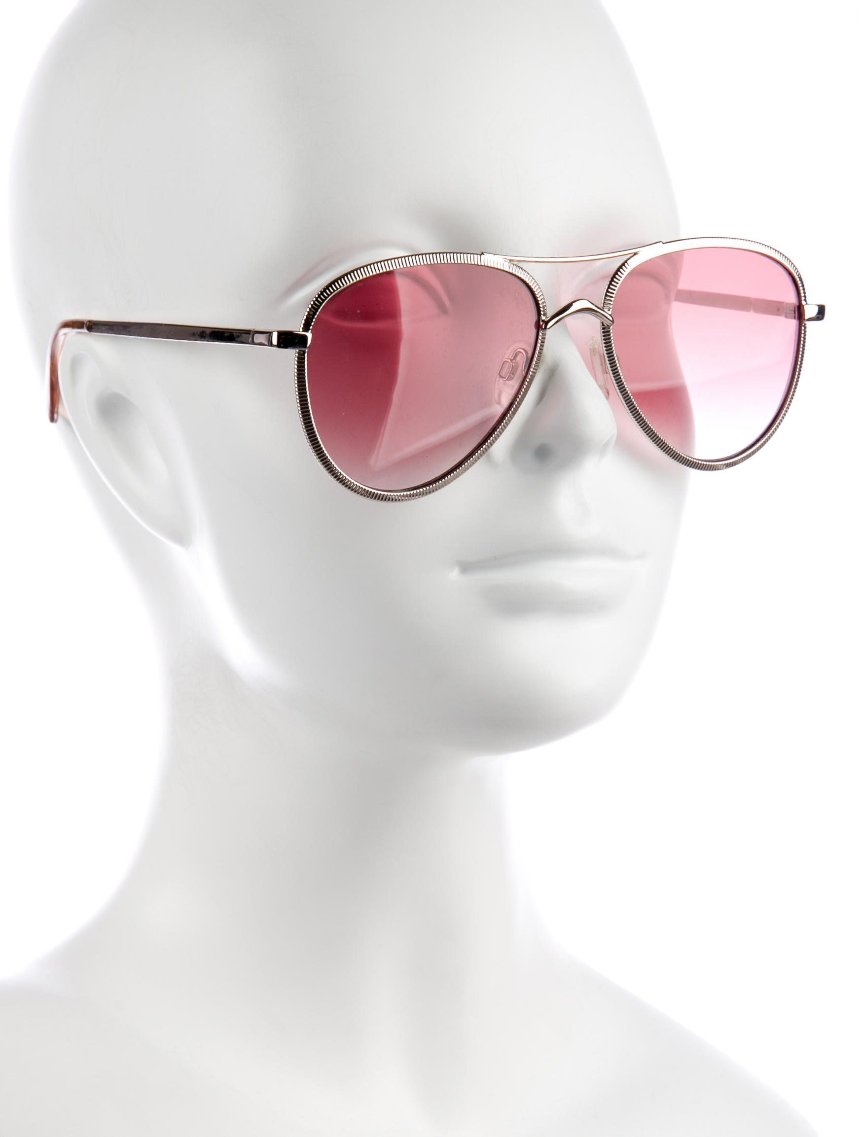 Silver metal Le Specs Empire sunglasses with tinted lenses