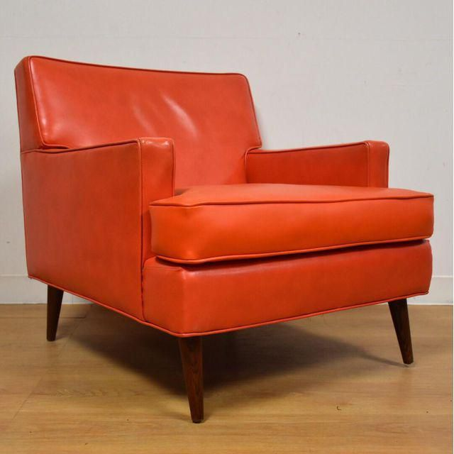 This Is A Mid Century Modern Orange Vinyl Lounge Chair With Dark Walnut  Colored Legs