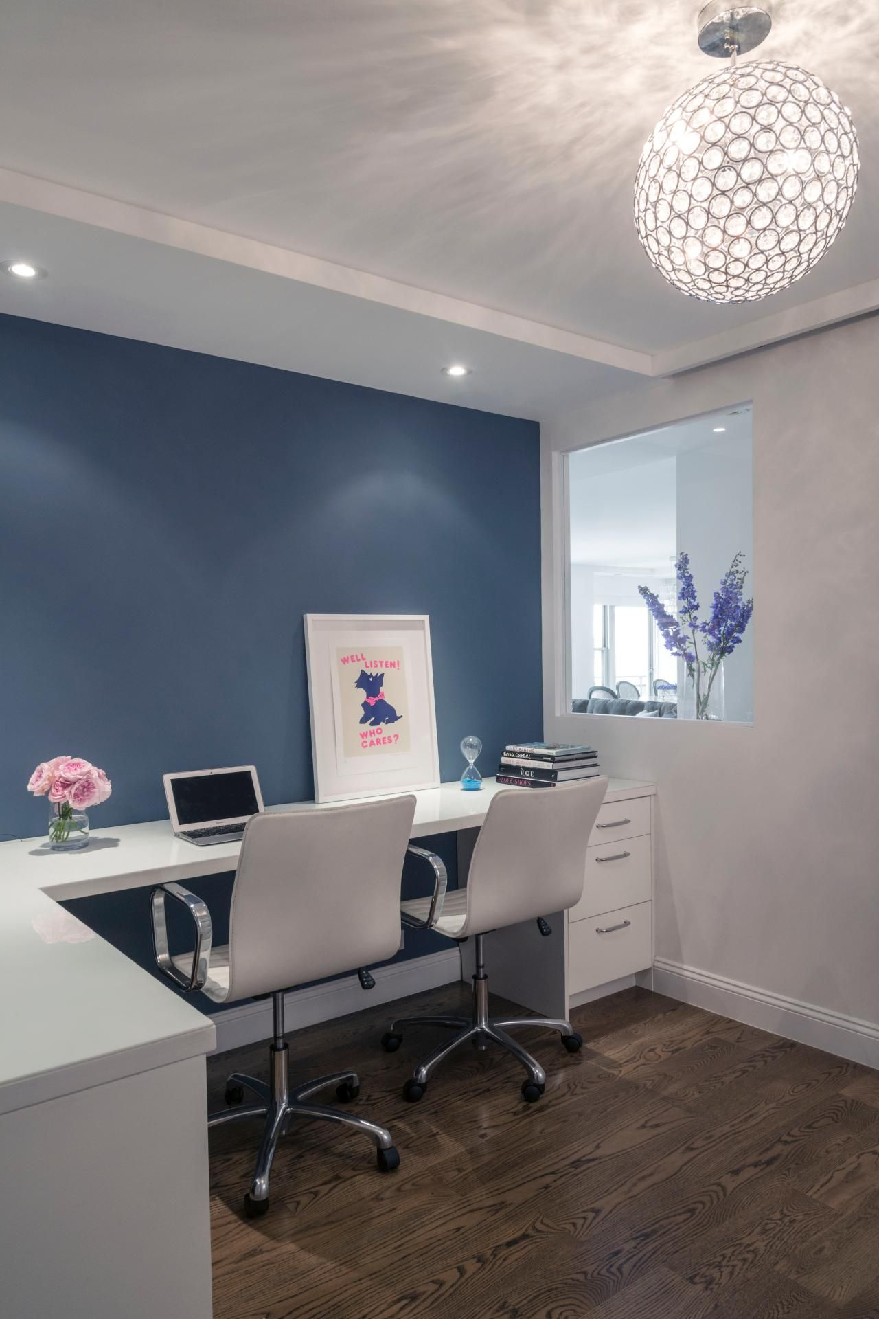 This Modern Home Office Features A White Desk With Two White