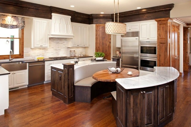 Curved Booth Style Kicthen Table Marble Countertop Wood Flooring White Cabinet Flowery C Round Kitchen Island Kitchen Island Design Kitchen Island With Seating