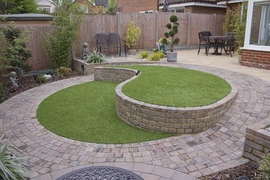 Conway Landscapes Built This And Was A Sloping Grassed Garden Designed So The Customer Had A More Usable Space Sloped Garden Garden Design Small Patio Design