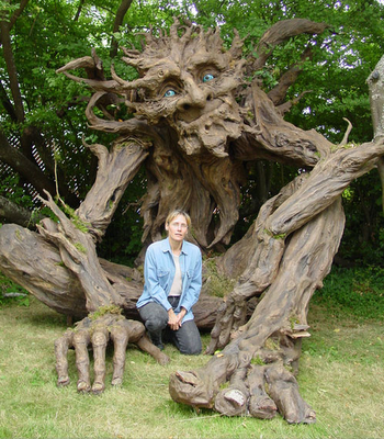 ...amazing sculpture: Seattle sculptress Kim Graham and her team made this amazing troll sculpture out of reclaimed lumber, discarded cardboard, and papier mache.