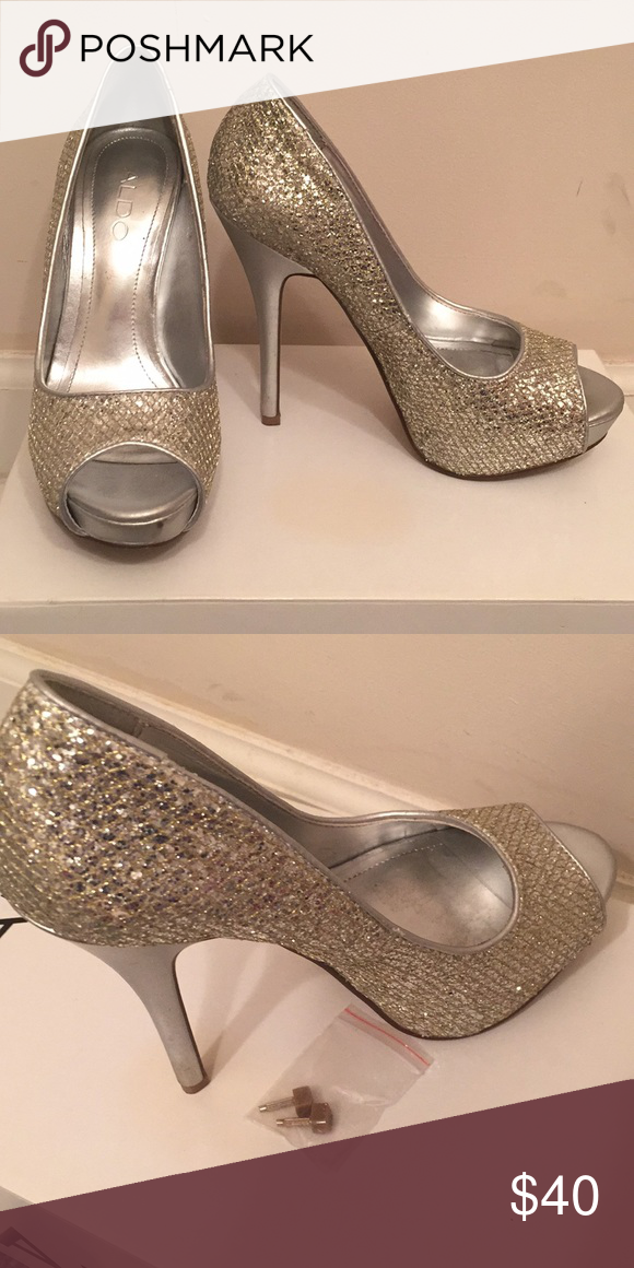 242d5d373221 ALDO Gold and silver peep toe holiday heels Size 36 B (or size 6) gorgeous sparkly  heels by ALDO. Comes with extra heel attachments. I only wore them twice.