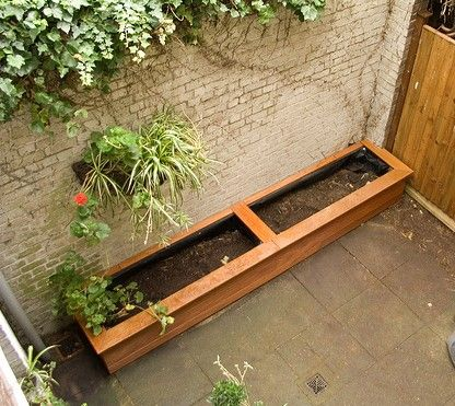 Wooden Garden Planters Ideas images of planter box genie backyard and patio wallpaper wooden planter boxeslarge Build Wooden Planter Boxes Backyard Wood Garden Planters E1310408833918 Build A Garden Box For