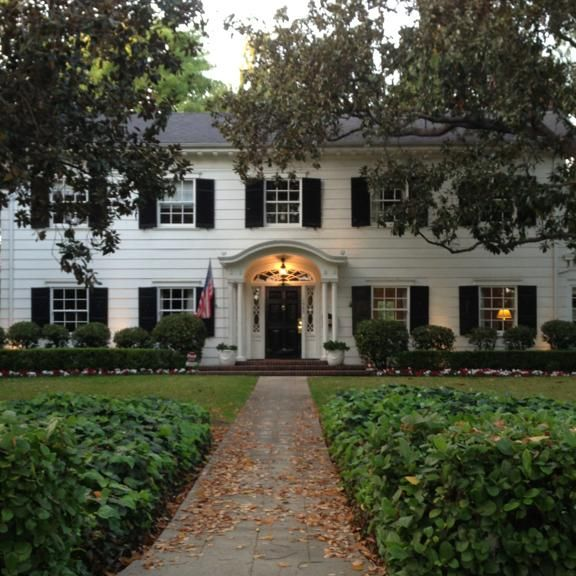 Exquisite black and white English Colonial style home ...