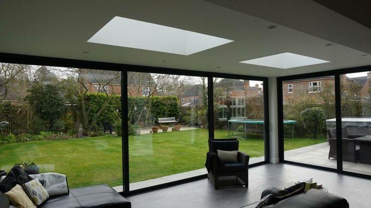 Casas de cristal para interiores luminosos | Paredes de vidrio ...