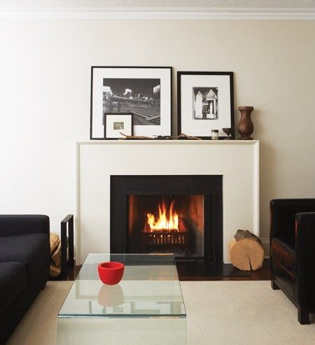 Minimalistic Fireplace Surround Constructed Of Black Granite And A
