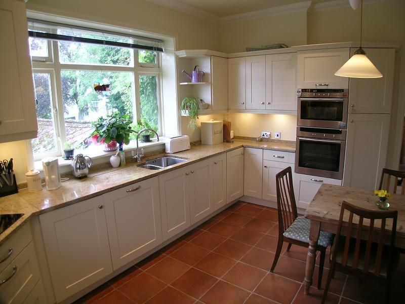 Photo Of Brown Odd Shapes Kitchen With Floor Tiles