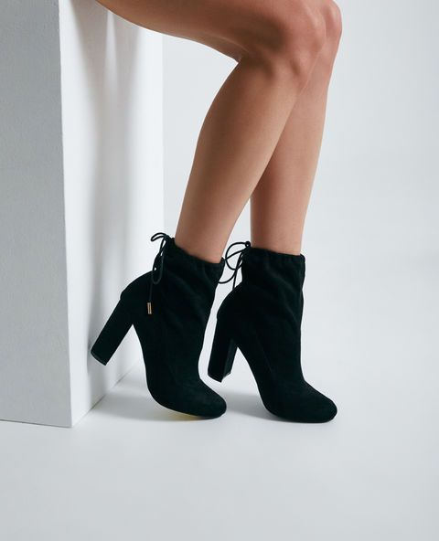 <p>A pair of dressy high ankle boots featuring a slouchy faux suede upper, a self-tie cuff with metal ends, and a faux suede block heel.</p>    <ul>  <li>5.5