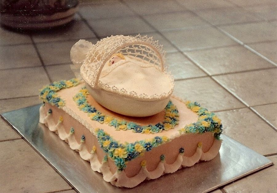 Janet's Sugar Art (Richmond, VA) - My baby shower cakes: Baby Bassinet -  Royal icing hood and lace pieces. Fondant baby and blanket..